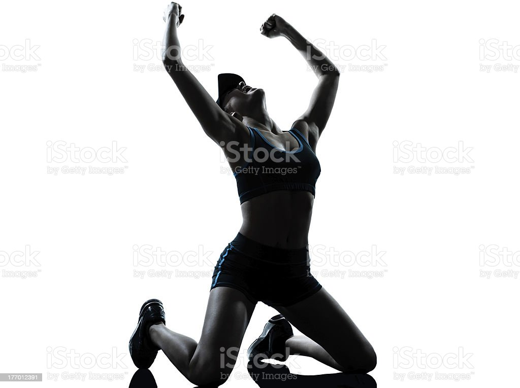 woman runner jogger kneeling winner victory royalty-free stock photo