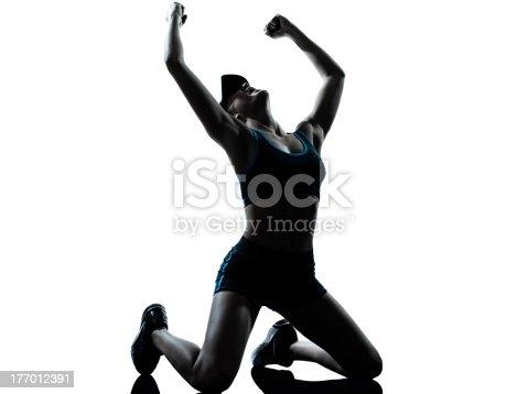 istock woman runner jogger kneeling winner victory 177012391