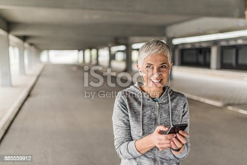istock Woman runner jogging in nature,listen music 885559912
