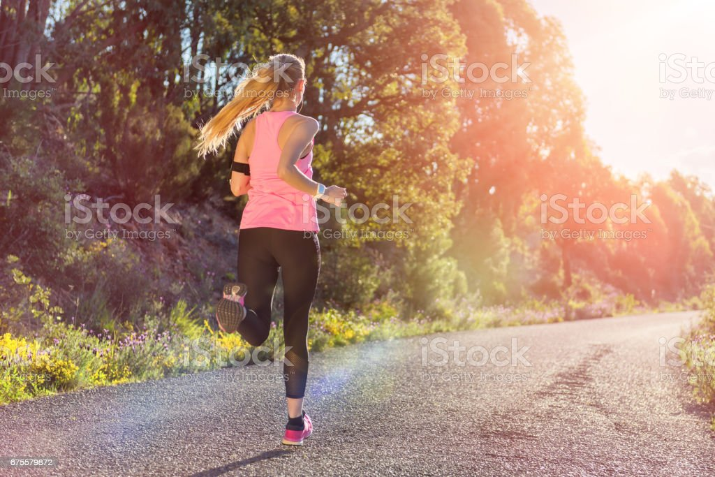 Woman runner running at forest trail foto de stock royalty-free