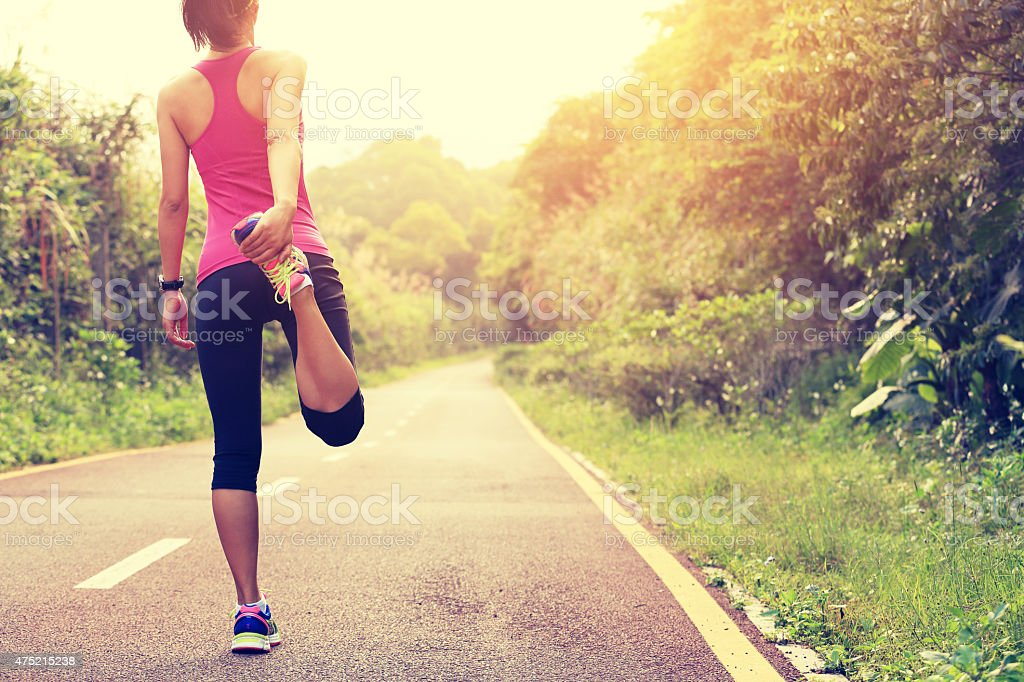 woman runner warm up outdoor stock photo