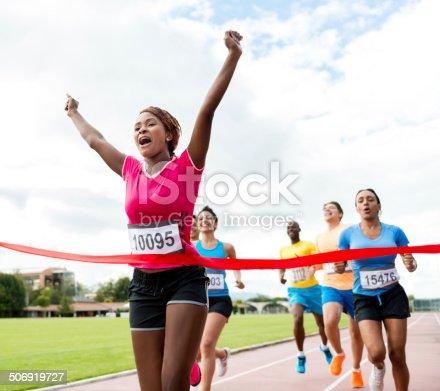 Woman running a marathon and winning