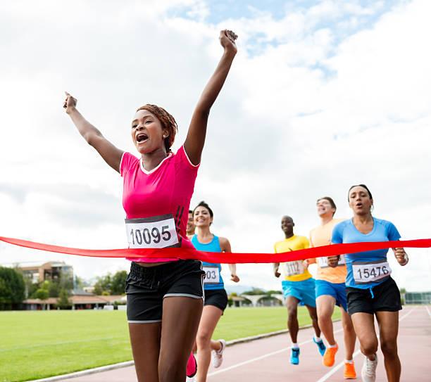Woman running a marathon stock photo