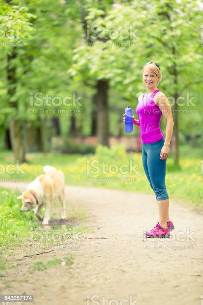 Woman running and jogging with dog in green summer park and woods picture id843257174?b=1&k=6&m=843257174&s=612x612&h=eid 2ov1ubevj0n6tjlfjfhavwezjkyz4kw8hpaku m=