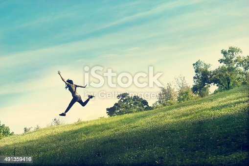 833314292istockphoto woman running and jumping funny relax on green grass flower 491359416