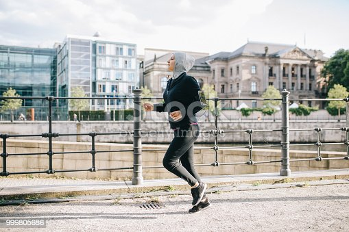 istock Woman running by the riverside 999805686