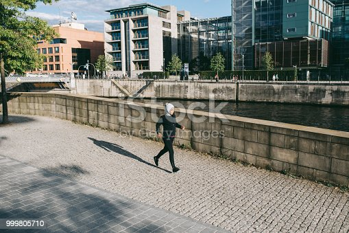 istock Woman running by the riverside 999805710