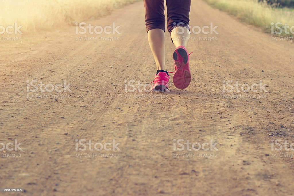 Woman running exercise on trail in summer nature, Blank text stock photo