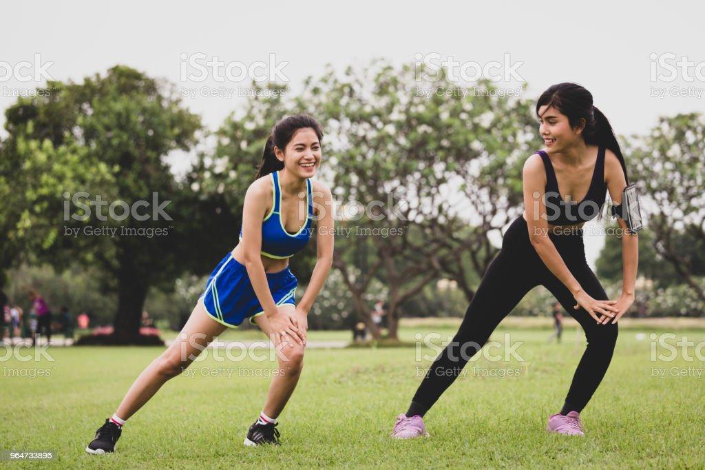 Woman running exercising at park royalty-free stock photo