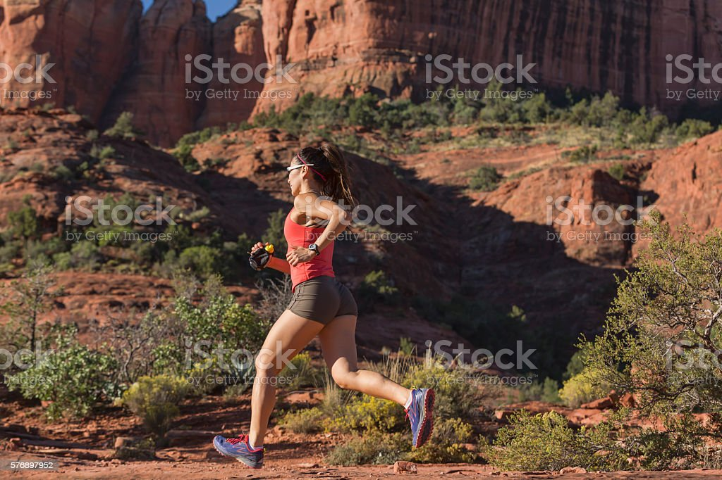 Woman Running Fast Outdoors stock photo