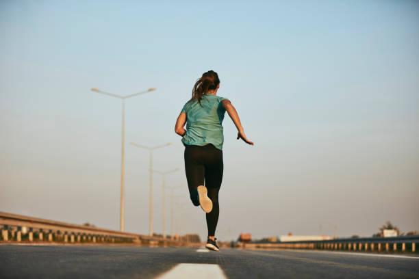 Woman running hard and sweating
