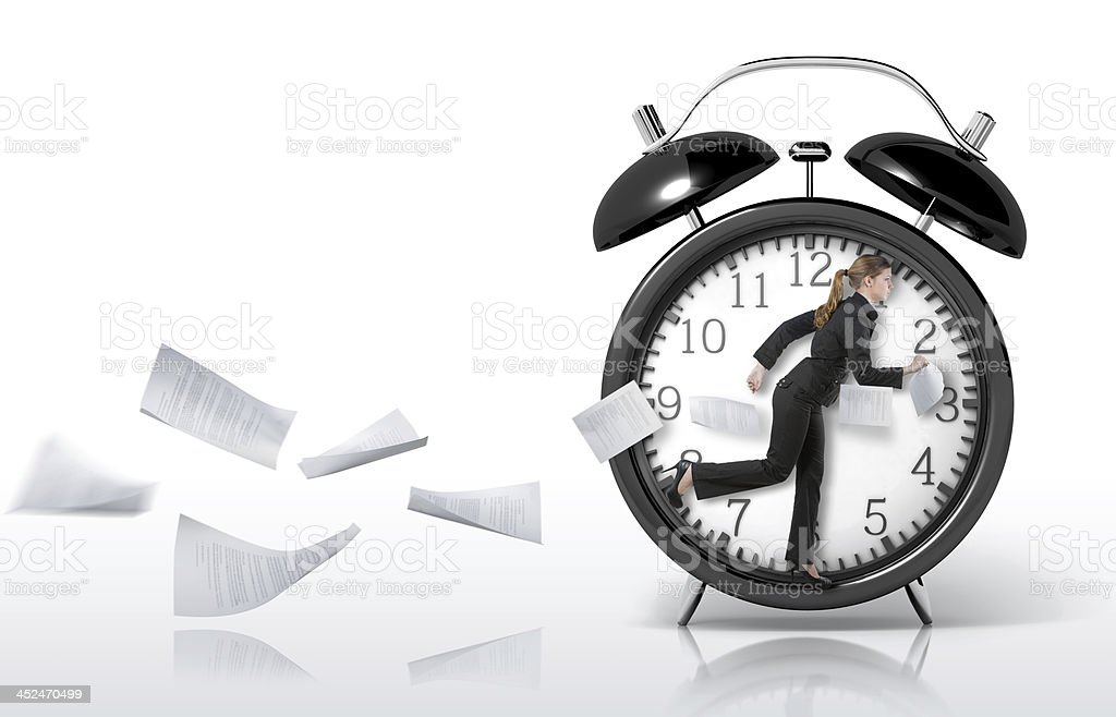 Woman running in a giant clock stock photo