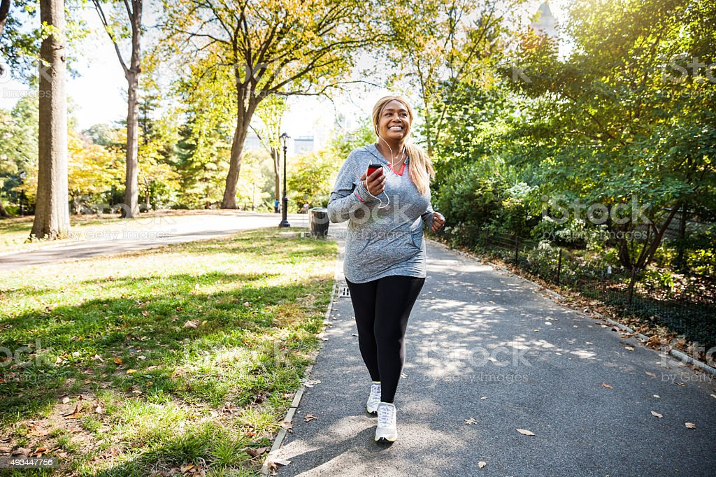 Woman running in Central Park New York stock photo