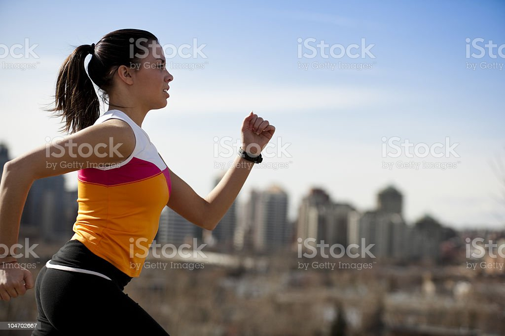 Woman Running in City stock photo