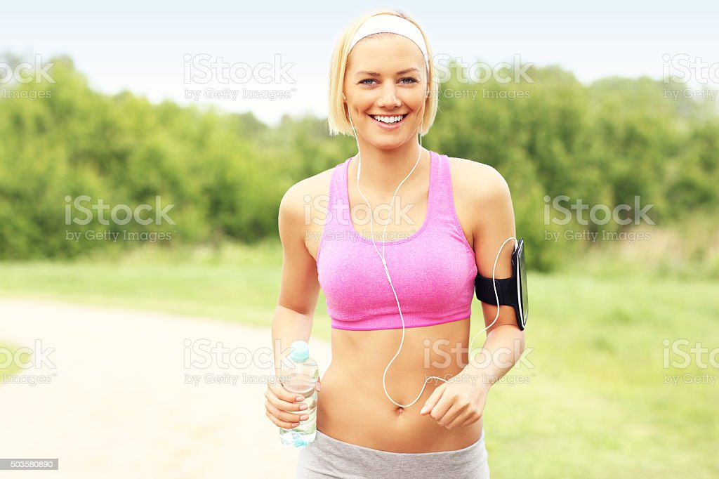 Woman running in the park stock photo