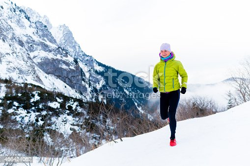 484750230 istock photo Woman running in winter, fitness inspiration and motivation 486424082