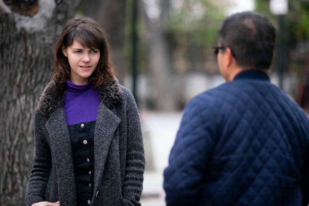 Woman Running Into an Ex Boyfriend or Insulted By Stranger stock photo