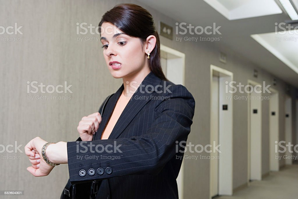 Woman running late stock photo