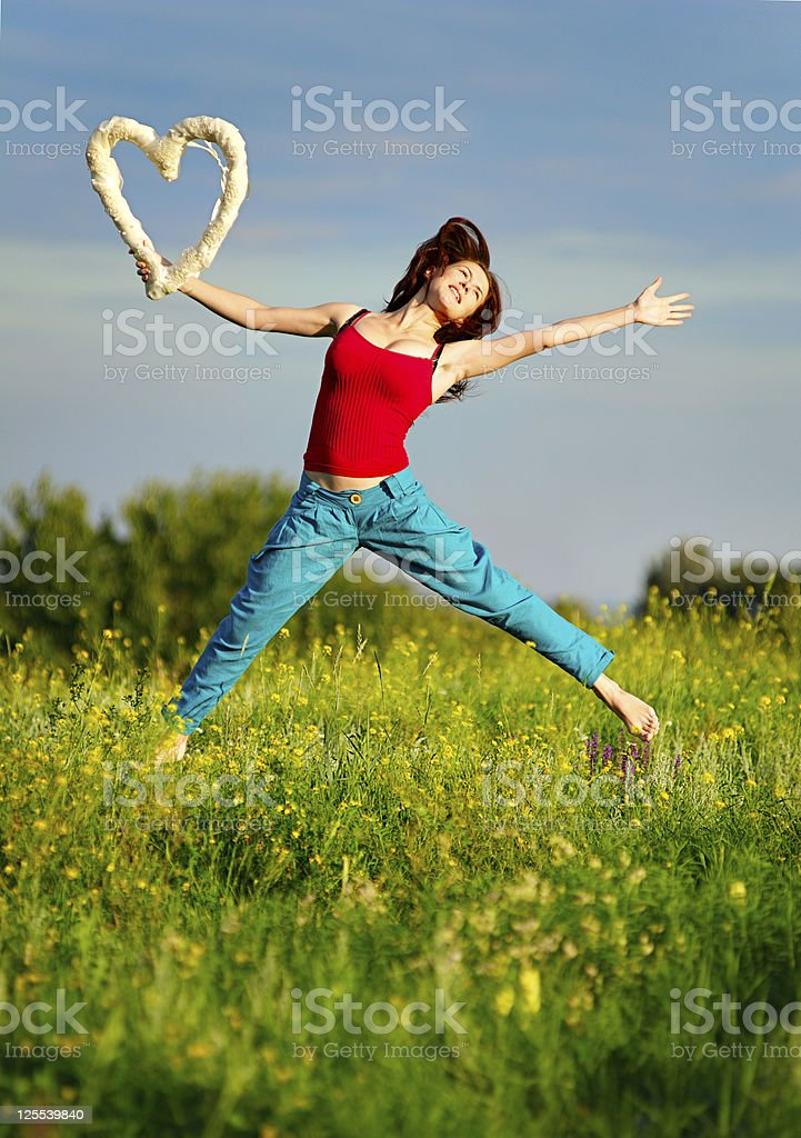 Woman running on a sunset field royalty-free stock photo