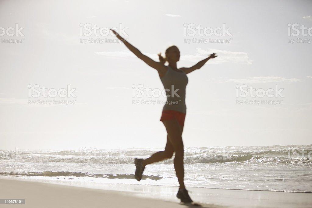 Woman running on beach royalty-free stock photo