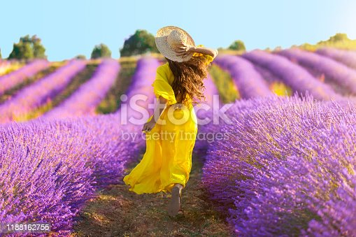 Woman running on lavender field