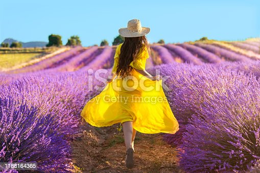 Woman running on lavender field