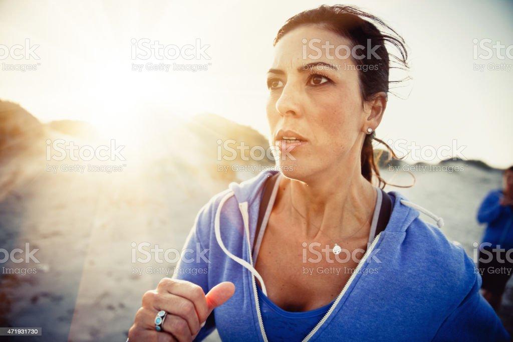 Woman running on the beach stock photo