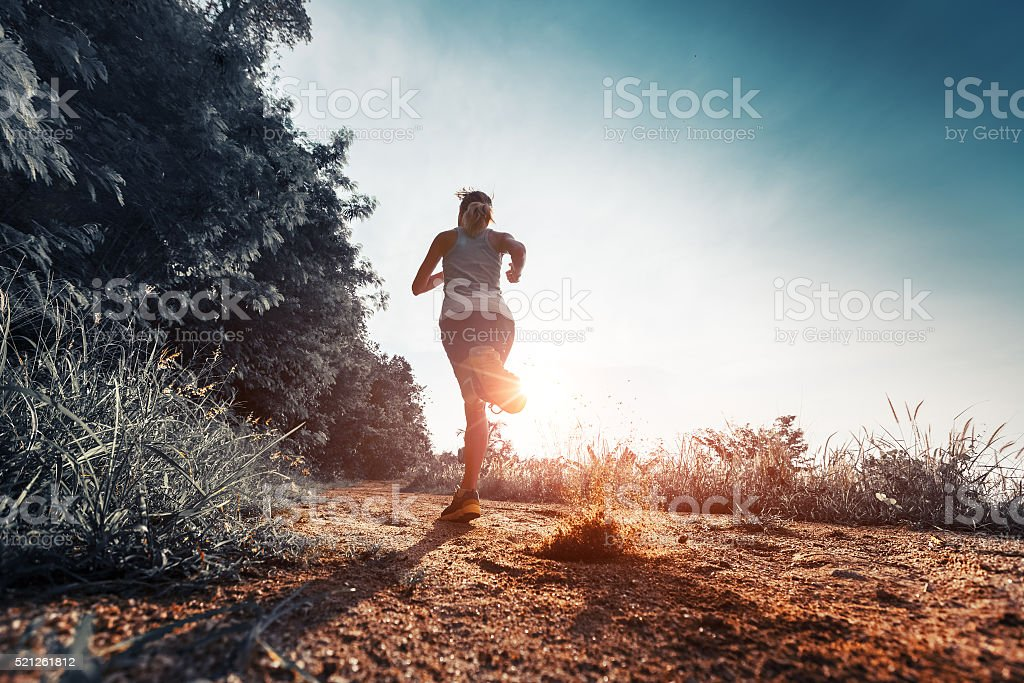 Woman running on the road stock photo