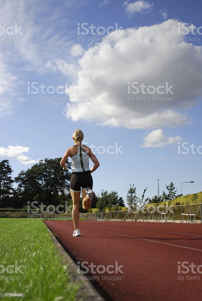 Woman running on track royalty-free stock photo