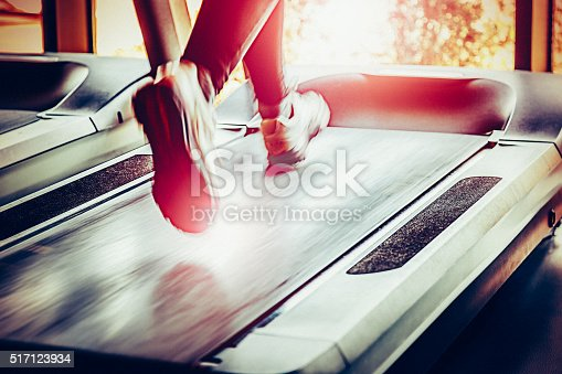 istock Woman running on treadmill 517123934