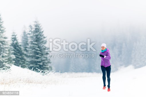 484750230 istock photo Woman running on winter trail, fitness inspiration and motivation 924834116