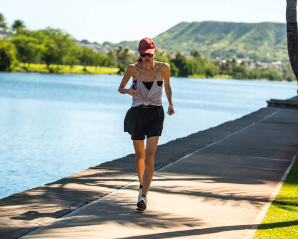 Woman running outdoors, Hawaii, USA stock photo