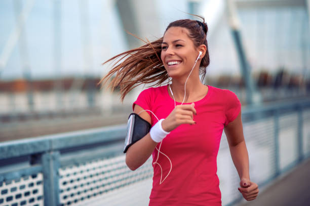 Woman running outdoors. stock photo
