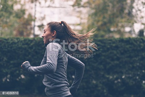 istock Woman running 614030510