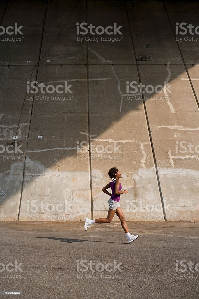 A woman running royalty-free stock photo