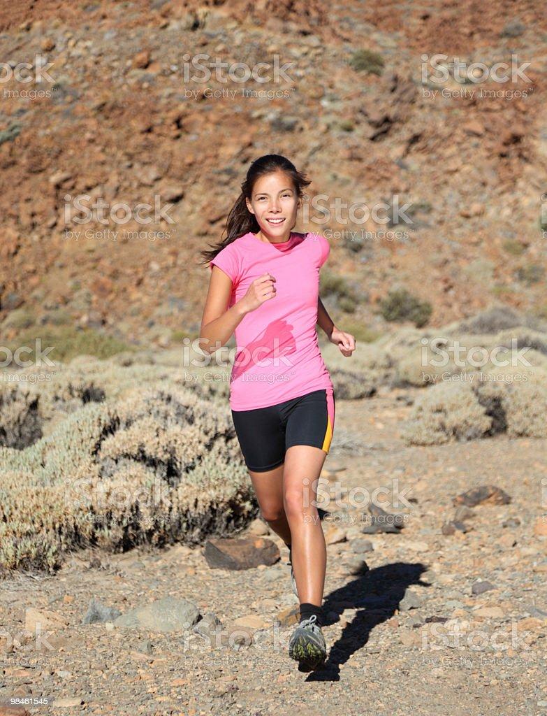 Woman running royalty-free stock photo