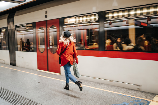 Woman running to catch the train