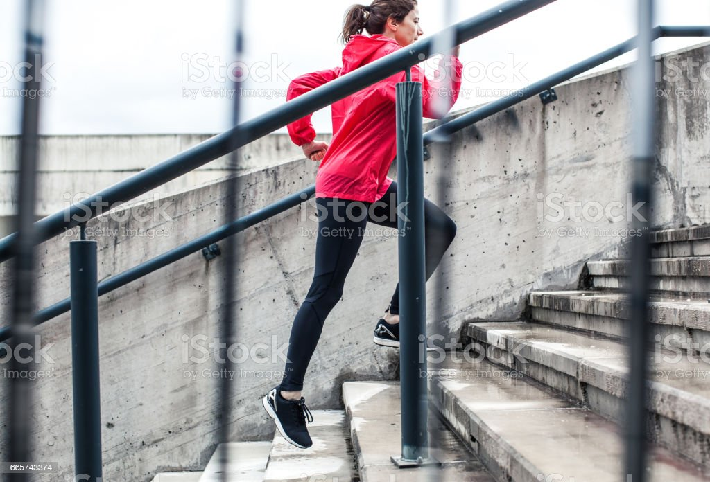 Woman Running Up The Stairs stock photo