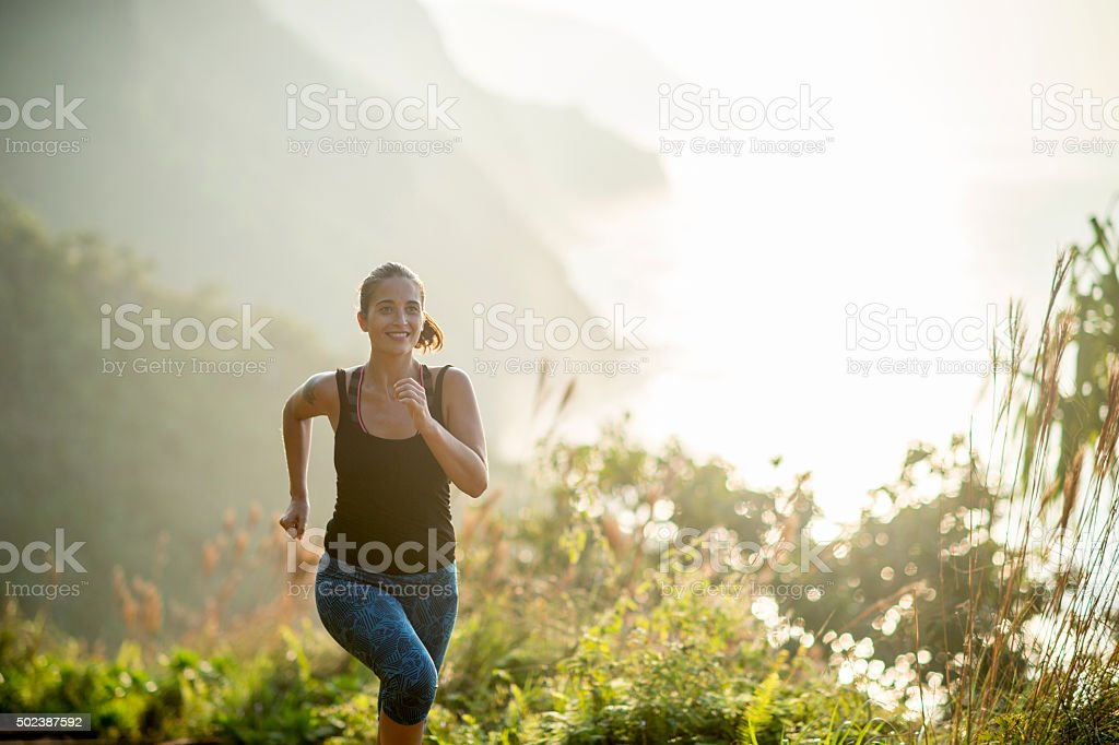 Woman Running While on Vacation in Hawaii stock photo