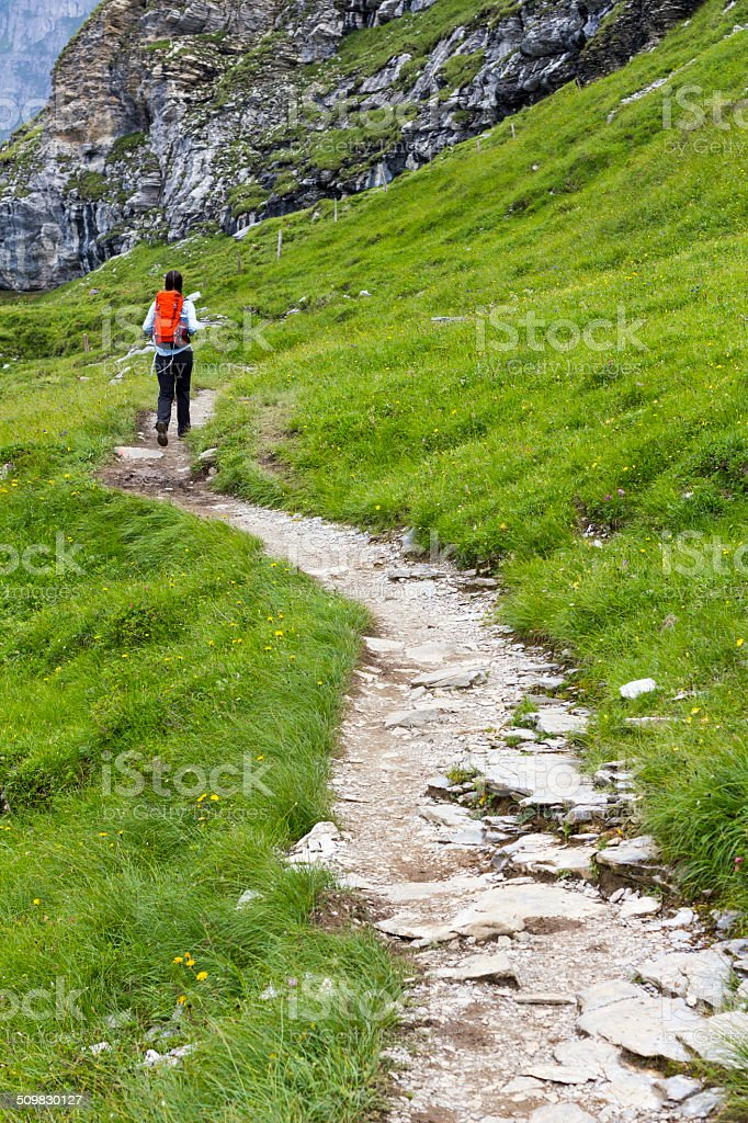 Woman Running with Backpack stock photo
