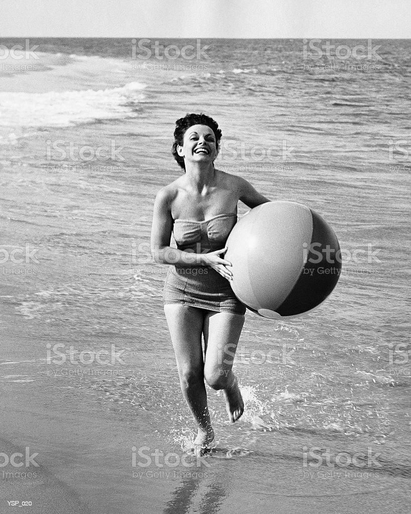 Woman running with beach ball royalty-free stock photo