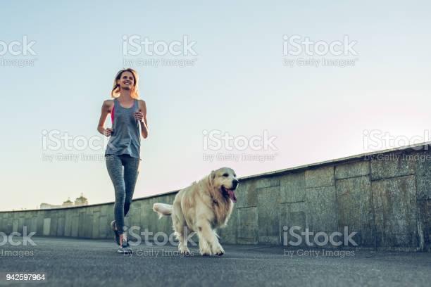 Woman running with dog picture id942597964?b=1&k=6&m=942597964&s=612x612&h=ds2yb0qtx p1a tvk02uwkergw7yaac7bkxfbmpsftm=
