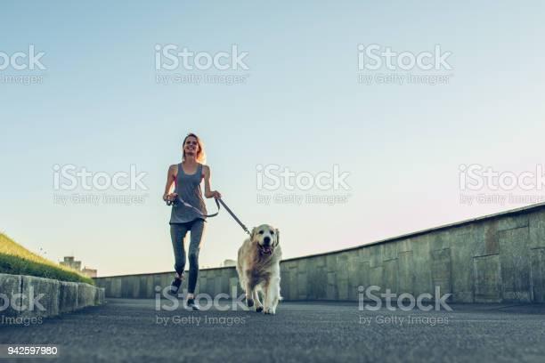 Woman running with dog picture id942597980?b=1&k=6&m=942597980&s=612x612&h=ulraypmgqp 3po5vjobloribgslmq qzzqtf jdqkzk=