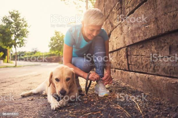 Woman running with her dog picture id984916302?b=1&k=6&m=984916302&s=612x612&h=eswyt ydozq wkfwihfvfrk9qi6kiunok5xutpfuvpc=