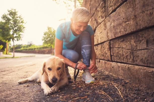 Woman running with her dog picture id984916302?b=1&k=6&m=984916302&s=612x612&w=0&h=salsezpdxnw adkbg1w19vpba6jarwuh0fvup fx8wq=
