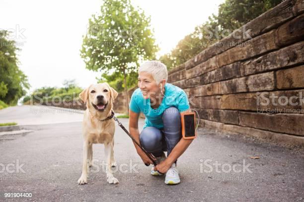 Woman running with her dog picture id991904400?b=1&k=6&m=991904400&s=612x612&h=pqelqpv3  pbyhgp2j bzefcgpdgf3iz5 5 4fnc2xi=