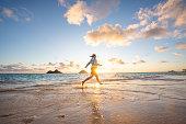 Sunlight illuminates distant islands, near Mokulua Island