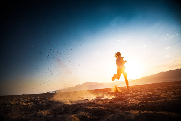woman runs on the desert - marathon stock photos and pictures