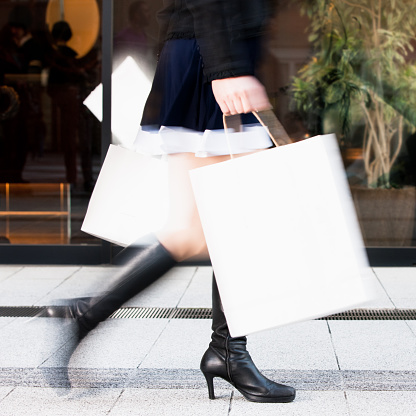 Woman rushing with shopping bags (Motion Blur)