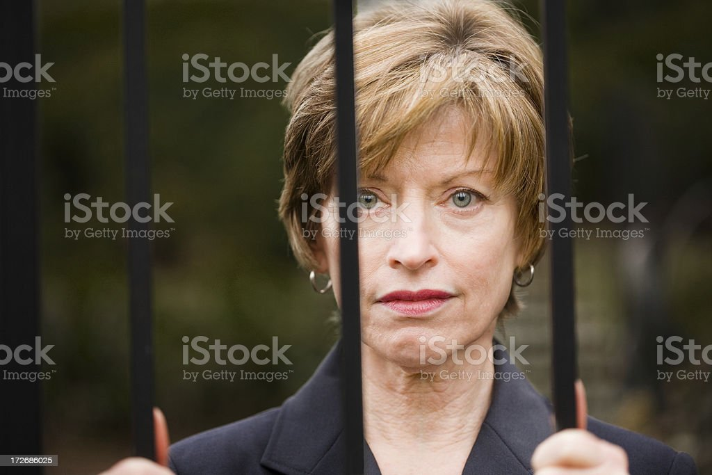 Woman sad behind bars royalty-free stock photo